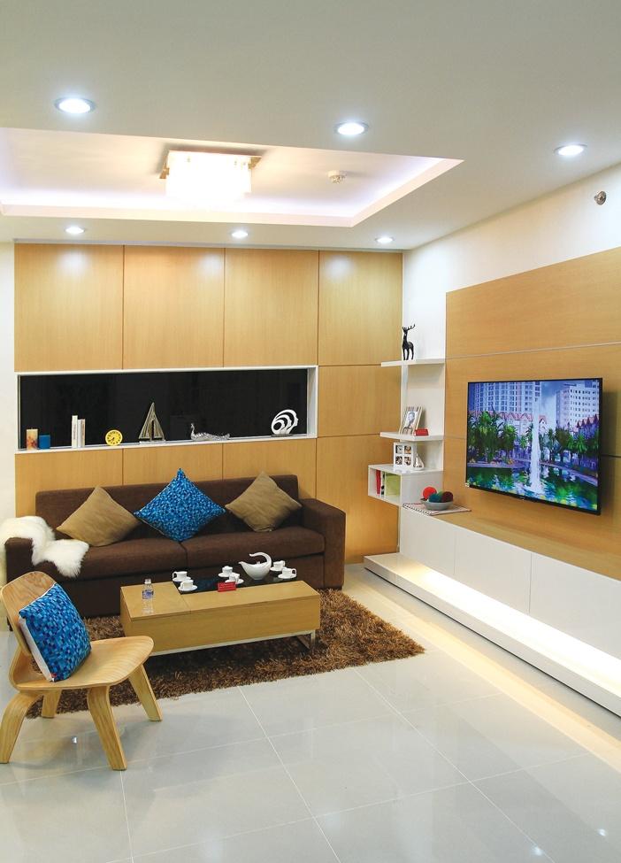 Phòng khách trong căn hộ chung cư chủ yếu là nơi sinh hoạt gia đình, bài trí thoải mái, mềm mại và hiện đại hơn