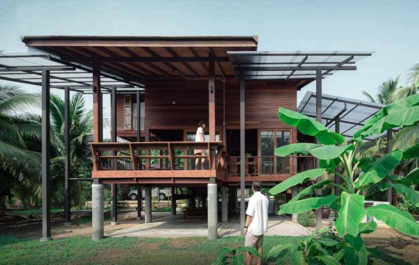 Ngôi nhà sàn gỗ ấm áp nằm giữa vườn dừa xanh mát - 1
