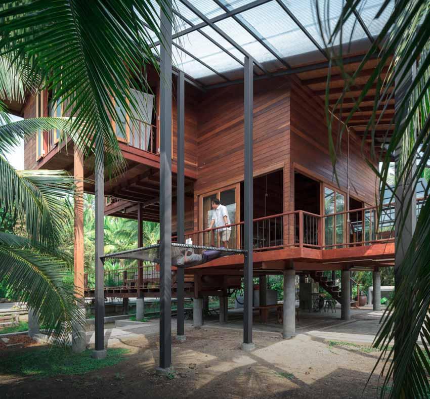 Ngôi nhà sàn gỗ ấm áp nằm giữa vườn dừa xanh mát - 6